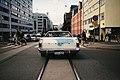 White Ford at a pedestrian crossing (Unsplash).jpg