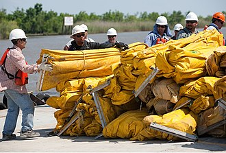 Deepwater Horizon oil spill response - Image: Workers building boom against oil spill after Deepwater Horizon disaster