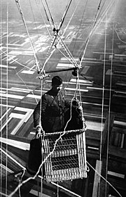 Close-up view of an American major in the basket of an observation balloon flying over territory near front lines.