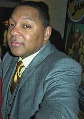 Marsalis reaching toward the camera