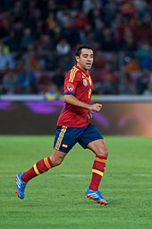 Xavi playing for Spain (courtesy of Wikipedia)