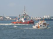 A small pleasure boat and a tugboat in Rotterdam