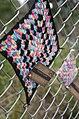 Yarn bomb - granny square on fence (5521346358).jpg