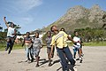 Young boys celebrate on a football pitch, Hout Bay, Cape Town, South Africa.jpg