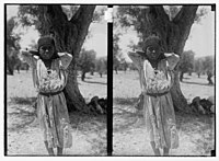 Young girl standing in front of a tree LOC matpc.06326.jpg