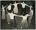 Young men and women dancing in a circle, circa 1950 (4407449748).jpg