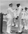 """Admiral C. W. Nimitz, CinCPac, pins Navy Cross on Doris Miller, at ceremony on board warship in Pearl Harbor, T. H."", 0 - NARA - 535857.tif"
