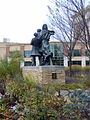 """The Selkirk Settlers"" sculpture in Winnipeg's Waterfront district.JPG"