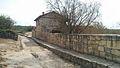 Рогожкин. Пещерный город Чуфут-Кале, Бахчисарай. Высокий тротуар и колеи для повозок на улице города.jpg