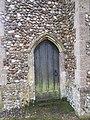 -2019-01-25 Doorway below the clock tower, North east corner of Saints Peter and Paul, Edgefield, Norfolk.JPG