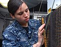 110702-N-MJ491-131 Aviation Electronics Technician Airman Analia Ovalle, from Fort Lee, N.J., troubleshoots a general purpose interface console.jpg