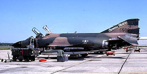"Coonass - McDonnell F-4C Phantom in Vietnam War camouflage, with ""Coonass Militia"" painted on the tail (1981)"