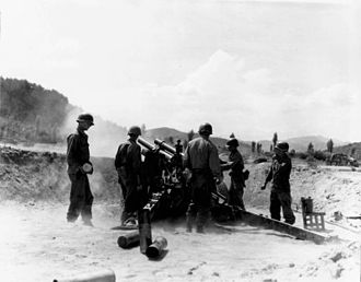 Battle of Taegu - US Artillery near Waegwan fires at North Korean troops attempting to cross the Naktong River