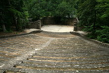 A stone amphitheater in the wooden location.