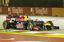 Webber driving for the Red Bull team under lights during the 2012 Singapore Grand Prix