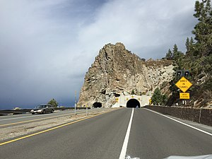 Cave Rock Tunnel - The Cave Rock Tunnel, viewed from eastbound US 50. The original bore (without the concrete liner) is to the left. The concrete lined bore was built when US 50 was widened to four lanes
