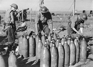 Barrage (artillery) - Men of the Australian Heavy Artillery capping 8-inch shells with '106' (instantaneous) fuses.
