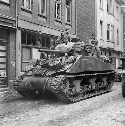 "A Sherman with track widening ""duckbill"" extended end connectors A Sherman tank of 8th Armoured Brigade in Kevelaer, Germany, 4 March 1945. B15145.jpg"