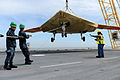 A U.S. Navy X-47B unmanned combat air system is loaded onto the flight deck of the aircraft carrier USS George H.W. Bush (CVN 77) in Norfolk, Va., May 6, 2013 130506-N-YZ751-290.jpg