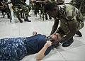 A boarding team member from the East African Standby Force places a neck brace on U.S. Navy Hospital Corpsman 2nd Class Teresa Able, a lead medical facilitator, during a first-aid course as part of Cutlass 131112-N-EZ054-088.jpg