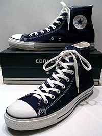 A classic Black pair of Converse All Stars resting on the Black & White Ed. Shoebox (1998-2002).JPG