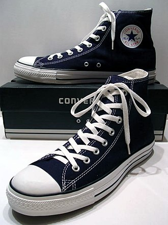 High-top - Image: A classic Black pair of Converse All Stars resting on the Black & White Ed. Shoebox (1998 2002)