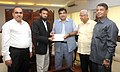 A delegation of Sea-Farers Association giving a donation for flood affected people of J&K to the Union Minister for Road Transport & Highways and Shipping, Shri Nitin Gadkari, in New Delhi on September 16, 2014.jpg