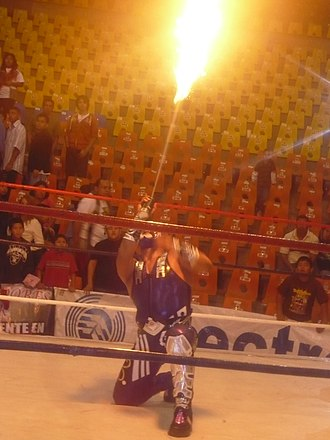 Abismo Negro - Abismo Negro with his signature flamethrower display.