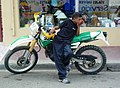 Adolescent Boy with Motorcycle - Jarabacoa - Dominican Republic (3813815098).jpg