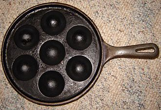 Æbleskiver - Top view of an æbleskiver pan.