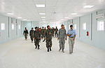 Afghan National Army soldiers and members of the End User Monitor Team inspect a barracks complex .jpg
