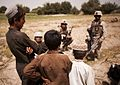 Afghan children speak to Marines (4989463655).jpg