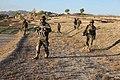 Afghan soldiers conduct a patrol through fields near Kharwar district's Musakhel village, in Logar province, Afghanistan, Oct. 19, 2011 111019-A-ZI978-016.jpg