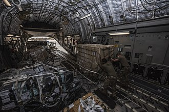 U.S. Air Force airmen unload a C-17 aircraft carrying approximately 1,800 kg (4,000 lb) of medical supplies in Niamey, Niger 23 April 2020. Air Forces Africa delivers medical supplies to Ghana (49829156488).jpg