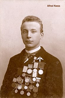 Alfred Ingvald Naess circa 1900 wearing his skating medals.jpg
