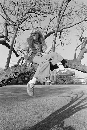 Amy Carter - Image: Amy Carter sitting in a tree on the White House grounds NARA 173811