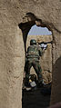 An Afghan National Army commando with the 3rd Company, 3rd Special Operations Kandak returns fire toward an identified enemy fighting position during a clearance operation in Bahlozi, Maiwand district, Kandahar 140101-A-LW390-303.jpg