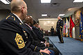 Army Gen. Martin E. Dempsey, chairman of the Joint Chiefs of Staff, speaks during a ceremony for retired Army Pfc. Mark A. Deville, center front, and his former platoon members to present Deville with a Silver 140128-D-KC128-064.jpg