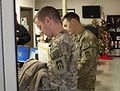 Army Spc. Brendon Arnold, of Avon, Ind., and Spc. Charles Huffnagle, of Cedar Lake, Ind., both with the 76th Infantry Brigade Combat Team, go through medical screening during the demobilization process at Camp 121129-A-PX072-005.jpg