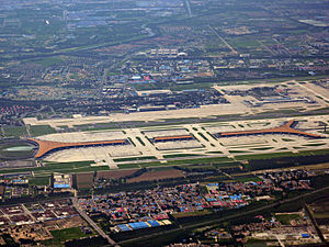Airport terminal - Aerial view of the Beijing Capital International Airport with Terminal 3 (orange roof) across the foreground; Terminals 2 (blue and white roof) and 1 (orange roof) in the upper right