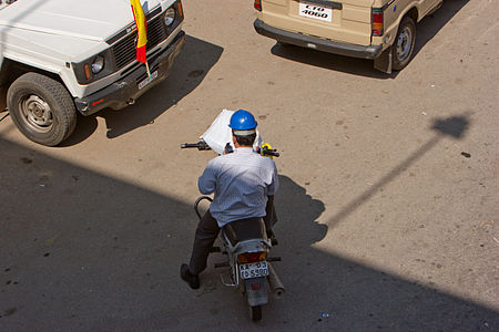 Bangalore construction guy on phone on bike November 2011 -5-3.jpg