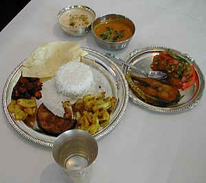Bengali cuisine - A Bengali meal traditionally set up.