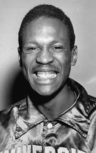 Bill Russell - Russell is all-smiles during his two national championship seasons at the University of San Francisco