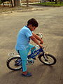 Blue clothed little cyclist boy - cycling near Nishapur railway station 05.JPG