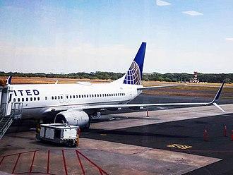 Monseñor Óscar Arnulfo Romero International Airport - Boeing 737-800 of United on gate 10 at Monsenor Oscar Arnulfo Romero International Airport