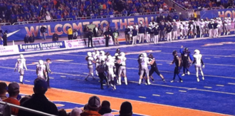 2013 Boise State Broncos football team - Dan Goodale kicking an extra point in the second half.
