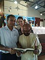 Bonaventure D'Pietro (right) takes a look at his newly released book.jpg