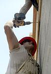 Bond beam work at Gabriela Mistral School construction site 150622-F-LP903-805.jpg