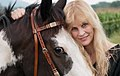 Bonnie U Gruenberg author and midwife with horse 2012.jpg