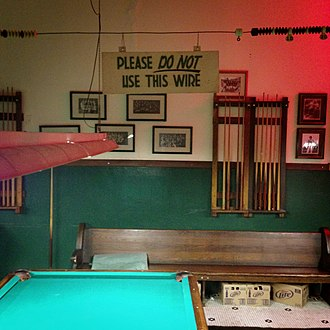 "Glossary of cue sports terms - A scoring wire at Booches in Columbia, Missouri, with a sign stating ""please do not use this wire"